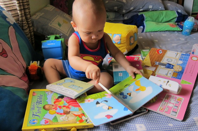 My one-year-old bookworm. One of my favorite pictures of my son.